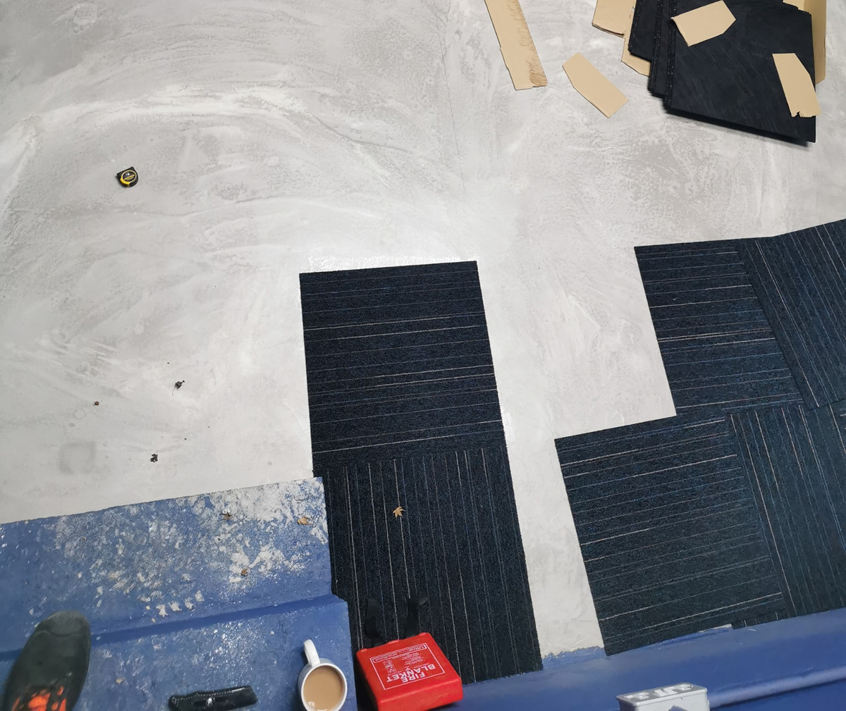 carpet tiles being laid